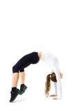 Młoda sportowa dziewczyna robi gimnastycznemu mostowi, odosobnionemu obraz royalty free