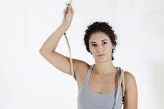 Młoda sportsmenka robi gimnastycznym ćwiczeniom Zdjęcie Stock