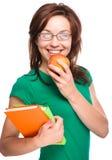 Młoda studencka dziewczyna trzyma książkę i jabłka Obraz Stock