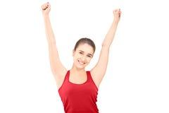 Młoda szczęśliwa kobieta gestykuluje szczęście z nastroszonymi rękami Zdjęcia Stock