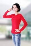 Młoda szczęśliwa kobieta gestykuluje wezwanie ja Zdjęcie Royalty Free
