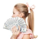 Młoda szczęśliwa kobieta z dolarami w ręce odosobniony Obrazy Stock