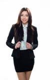 Młoda uśmiechnięta dziewczyna w biznesów ubraniach odizolowywających na bielu Zdjęcie Stock