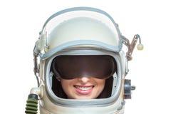 Młoda uśmiechnięta kobieta jest ubranym astronautycznego kostium odizolowywającego na białym tle Astronautyczny piękno astronauty zdjęcie stock