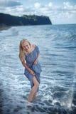 Młoda uśmiechnięta kobieta w długiej sukni obraz royalty free