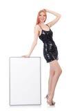 Młoda wysoka kobiety mienia pustego miejsca deska odizolowywająca dalej Fotografia Royalty Free