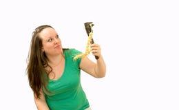 Młode kobiety z narzędziem i rośliną Zdjęcia Royalty Free