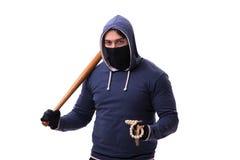 Młodego człowieka chuligan z kijem bejsbolowym odizolowywającym na bielu Zdjęcie Royalty Free