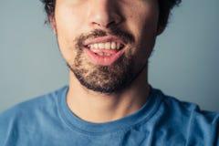 Młodego człowieka ciągnięcia twarze fotografia stock