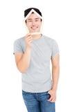 Młodego człowieka mienia dom kształtujący popsicle wtyka na twarzy Obraz Royalty Free