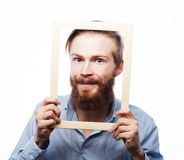 Młodego człowieka mienia obrazka rama Fotografia Stock