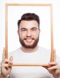 Młodego człowieka mienia obrazka rama Fotografia Royalty Free