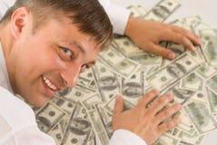 Młodego człowieka mienia pieniądze fotografia stock