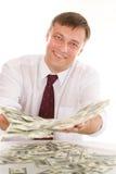 Młodego człowieka mienia pieniądze obraz royalty free
