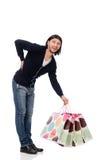 Młodego człowieka mienia plastikowi worki odizolowywający na bielu Zdjęcie Royalty Free