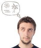 Młodego człowieka przyglądający up marzyć o plaży Zdjęcia Stock