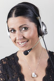 Młodego klienta agent jest ubranym hełmofony Zdjęcie Stock
