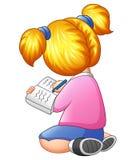 Młodej dziewczyny obsiadanie z writing na książce Zdjęcie Royalty Free