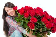 Młodej kobiety c bukiet czerwone róże Fotografia Royalty Free