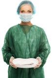 Młodej kobiety lekarka w nakrętki i twarzy masce Obraz Stock