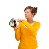 Młodej kobiety mienia alrm zegar Fotografia Stock