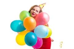 Młodej kobiety mienia balony obrazy stock
