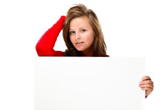Młoda atrakcyjna kobieta za pustą deską na białym tle obraz royalty free