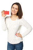 Młodej kobiety mienia pusta kredytowa karta nad białym tłem, Zdjęcie Royalty Free