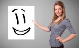 Młodej kobiety mienia smiley twarzy rysunek ilustracji