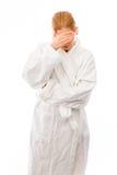 Młodej kobiety pozycja w bathrobe zakrywa jej twarz z jej ręką Zdjęcie Stock