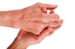 Młodej kobiety ręki mienia starszych osob mężczyzna ręka na białym tle obrazy stock