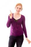 Młodej kobiety wskazywać up i uśmiechnięty Fotografia Stock