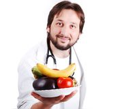 Młodej samiec doktorski advicing zdrowy naturalny jedzenie zdjęcia royalty free