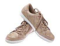 Młodość bawi się obuwie butów brąz. Zdjęcia Royalty Free