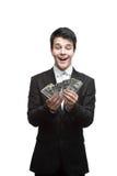 Młody śmieszny biznesowego mężczyzna mienia pieniądze Obraz Stock