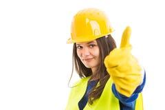 Młody żeński konstruktor pokazuje kciuk up obraz stock