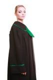 Młody żeński prawnika adwokat jest ubranym klasyczną połysku czerni zieleni togę Zdjęcie Royalty Free