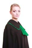 Młody żeński prawnika adwokat jest ubranym klasyczną połysku czerni zieleni togę Fotografia Royalty Free