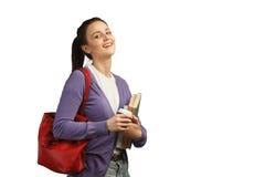 Młody żeński uczeń z książkami i plecakiem Fotografia Stock