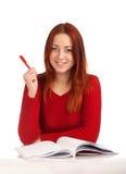 Młody żeńskiego ucznia studiowanie fotografia stock