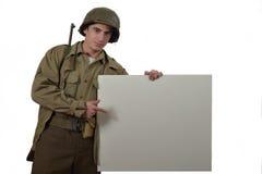 Młody Amerykański żołnierz pokazuje znaka Zdjęcia Royalty Free