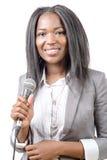 Młody amerykanina afrykańskiego pochodzenia dziennikarz z mikrofonem Zdjęcie Stock