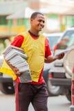 Młody Arabski mężczyzna sprzedawanie rezerwuje na miasto ulicie zdjęcie royalty free