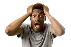 Młody atrakcyjny afro amerykański mężczyzna desperacki w szoku z rozpieczętowanym usta martwił się Zdjęcia Stock