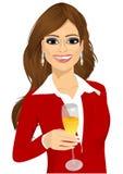 Młody atrakcyjny bizneswoman wznosi toast z szkłem szampan Obraz Stock