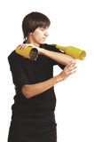 Młody barman z butelką i potrząsaczem obraz stock