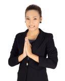 Młody biznes z Tajlandzką płaci szacunek posturą fotografia royalty free