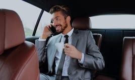 Młody biznesmen ma kawę w jego samochodzie Zdjęcie Royalty Free