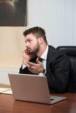 Młody biznesmen na telefonie obrazy stock