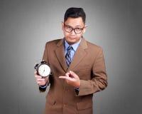Młody biznesmen Pokazuje czas, Poważny wyrażenie obrazy stock